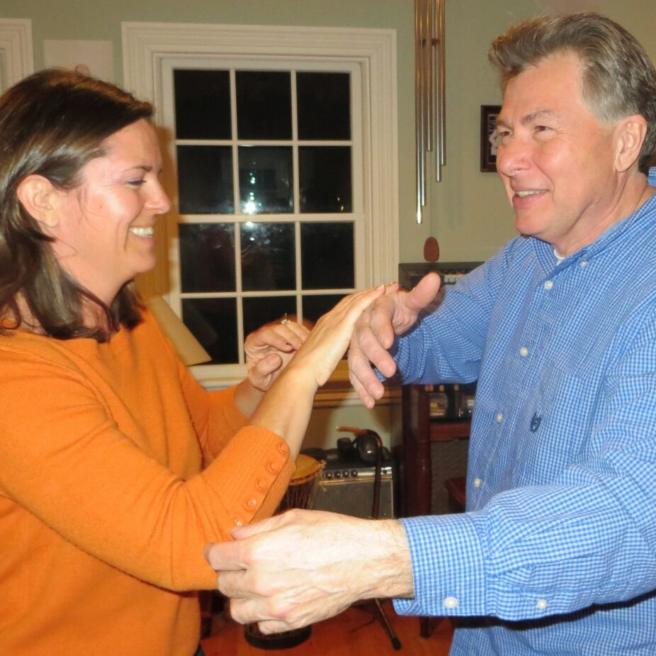 Instructor Fred Willette and student practicing Tai Chi push hands